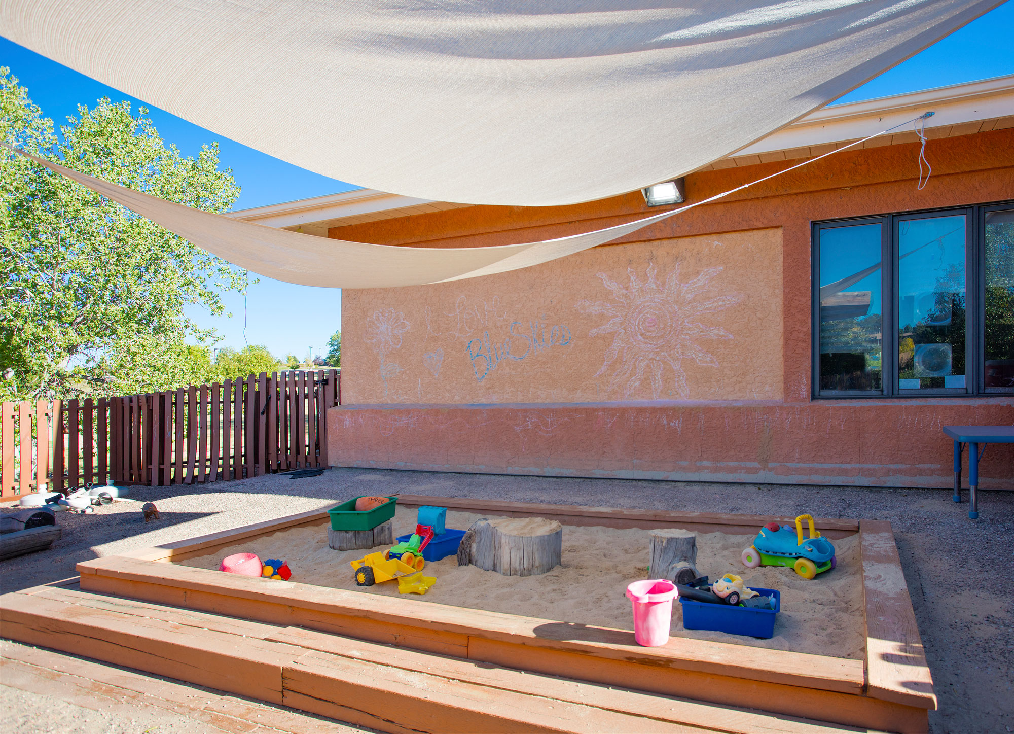 Image of sandbox with toys outside of the learning center.